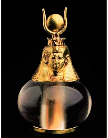 crystal quartz and solid gold adorned bottle used for fragrant oils with the bust of Goddess Het-Heru (Hathor)