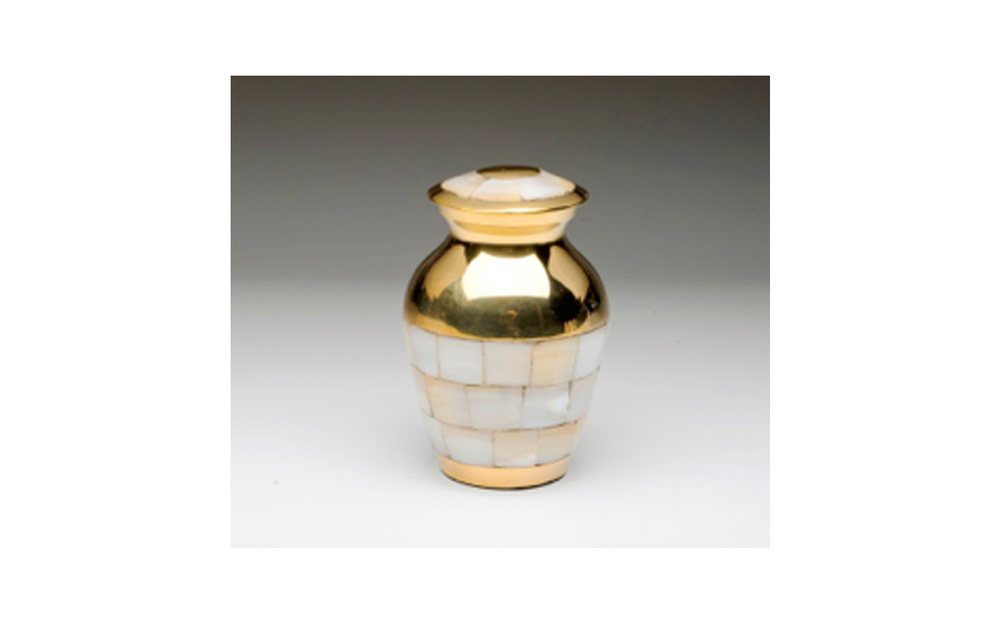 "Mother of Pearl Golden Brass Keepsake This Golden Brass keepsake urn comes with a Beautiful Mother of Pearl Inlay, Threaded Lid, Felt-Lined Base, and a Velvet Box. Measures 3"" H, 3 Cu. Inches, up to 2 lbs., $50"