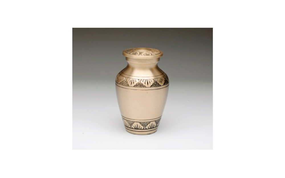 "Athena Brass & Pewter Keepsake This keepsake comes in either Brushed Brass (shown) or Pewter with a Hand Tooled Design, Threaded Lid, Felt-Lined Base, and a Velvet Box. Measures 2.75"" H x 1.75"" W, 3 Cu. Inches, up to 2 lbs., $45"