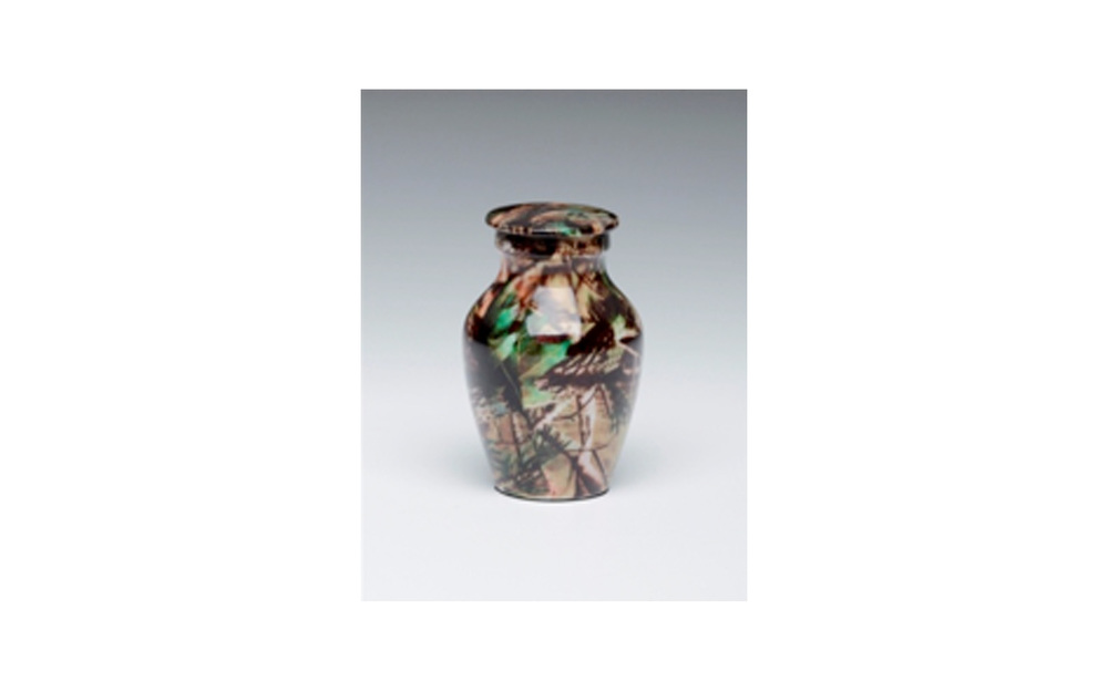 "Mossy Oak Camouflage Keepsake This keepsake displays a ""Camouflage"" Design, is highly durable, and has a Threaded Lid. Measures 2 ¾"" H, 3 Cu. Inches, up to 2 lbs., $45"