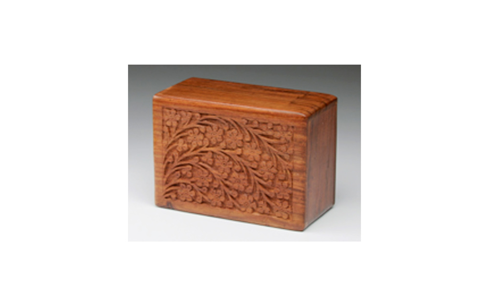 "Tree of Life This urn is hand carved and made of solid rosewood. This urn has a slide out base and is available in XLarge, Large, Medium, Small, and XSmall sizes. XLarge: Measures 9.5"" L x 6.5"" W x 5"" H, 218 Cu. Inches, up to 213 lbs., $75 Large: Measures 9"" L x 6.5"" W x 4.5"" H, 185 Cu. Inches, up to 180 lbs., $65 Medium: Measures 7"" L x 5"" W x 3.75"" H, 70 Cu. Inches, up to 65 lbs., $55 Small: Measures 6"" L x 4"" W x 2.75"" H, 30 Cu. Inches, up to 25 lbs., $45 XSmall: Measures 5"" L x 3"" W x 2"" H, 10 Cu. Inches, up to 5 lbs., $35"