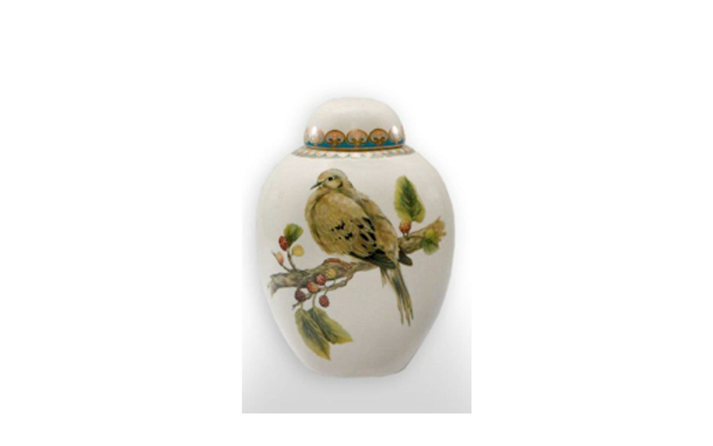 "Avian Ceramic Urn    This ceramic urn presents a peacefulness, beauty, and grace of the bird. This urn measures 5"" L x 5"" W x 7 ½"" H, and holds 75 Cu. Inches, up to 75 lbs. $125 *Please Note: Each piece is uniquely made by its Artist resulting in different colors and weight"