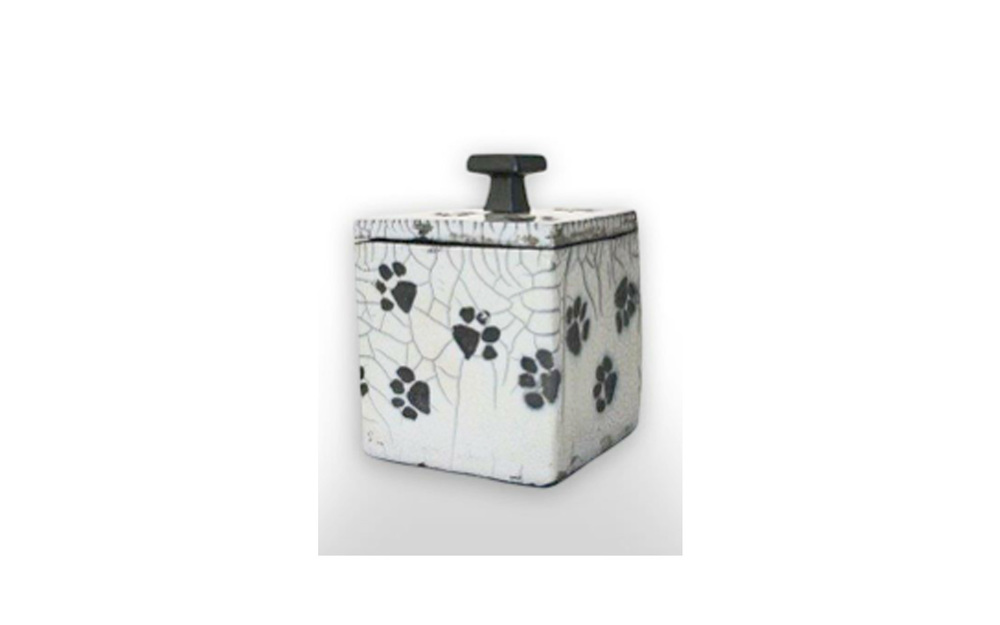 "Playful Paws Square Ceramic Pet Urn    This ceramic urn is a one of a kind Crackled Glazed Cube giving an antique like appearance measuring 4"" L x 3 ¾"" W x 5 ¼"" H, 36 Cu. Inches, up to 36 lbs. $130 *Please Note: Each piece is uniquely made by its Artist resulting in different colors and weight"