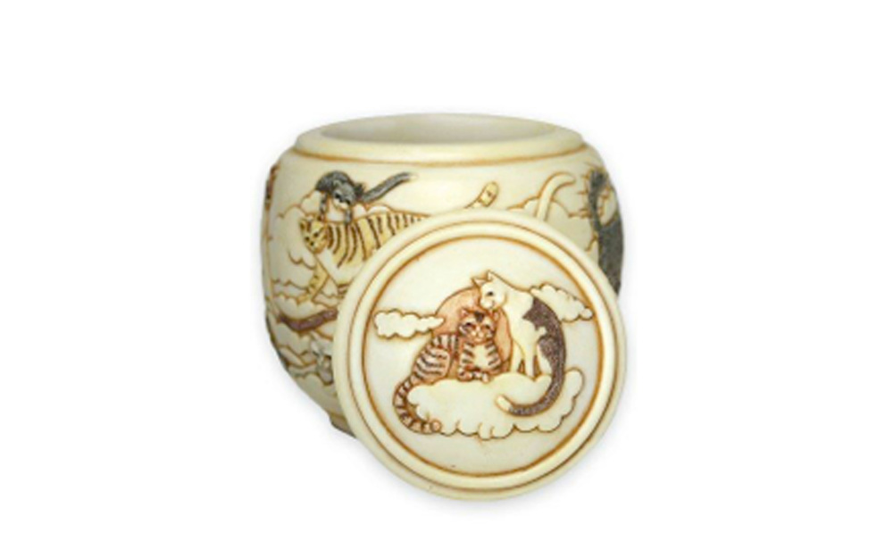 "Cats on High Pet Urn   This urn displays the beauty of our beloved cats who have passed and their gracefulness in the peacefulness of the sky, clouds, and sun. This urn measures 4 ½"" L x 4 ½"" W x 4 ¼"" H, 20 Cu. Inches, up to 20 lbs. $110 *Please Note: Each piece is uniquely made by its Artist resulting in different colors and weight"