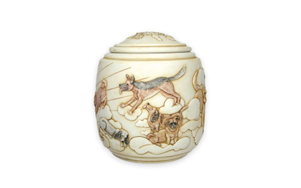 "Eternal Sunshine    This urn displays the beauty of our beloved dogs who have passed and their gracefulness in the peacefulness of the sky, clouds, and sun. This urn measures 5 ½"" L x 5 ½"" W x 5 ½""H, 42 Cu. Inches, up to 42 lbs. $120 *Please Note: Each piece is uniquely made by its Artist resulting in different colors and weight"
