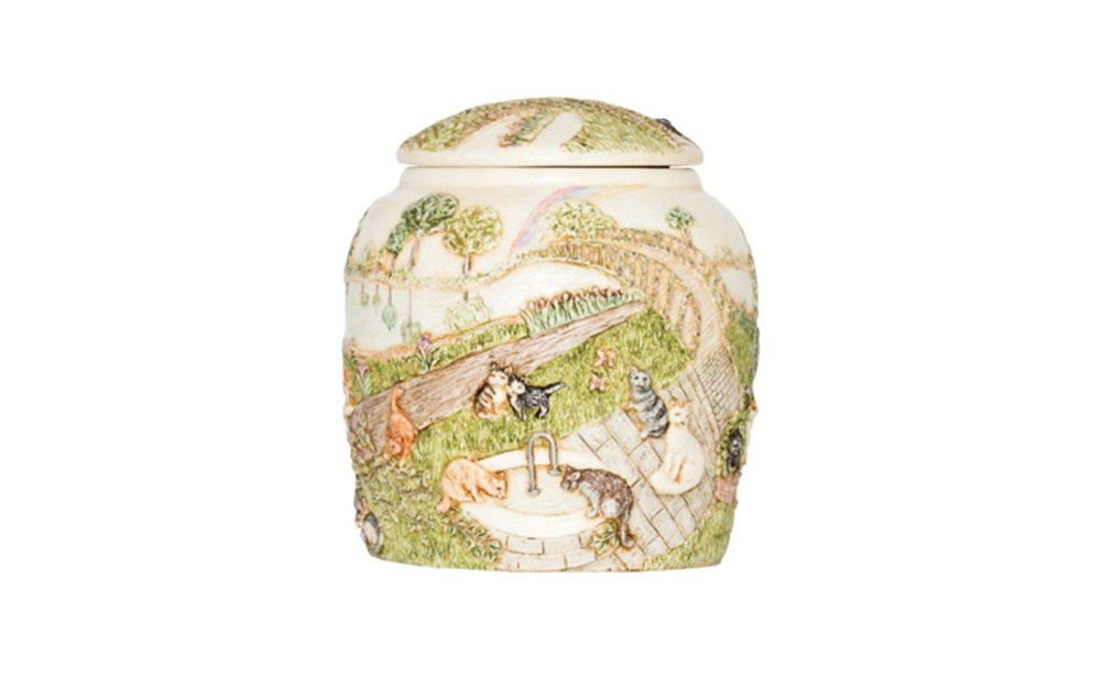 "Heaven's Happy Meadow Cat Urn   Hand crafted based upon the popular poem ""The Rainbow Bridge"" this urn displays peace and happiness. This urn measures 3 ¾"" L x 3 ¾"" W x 4"" H, 14 Cu. Inches, up to 14 lbs. $105 *Please Note: Each piece is uniquely made by its Artist resulting in different colors and weight"