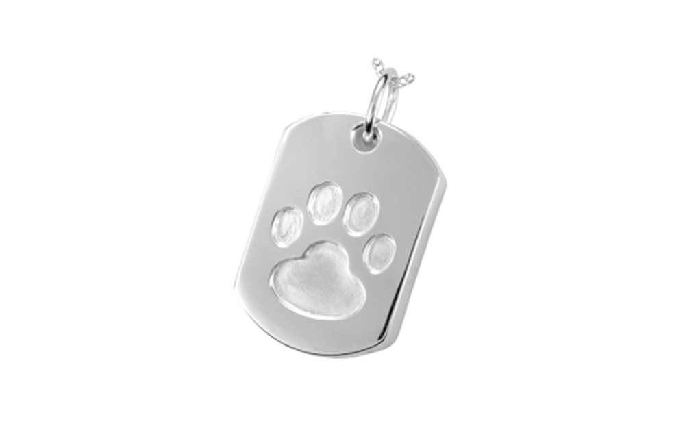 "Dog Tag Pendant   This pendant is made of Sterling Silver and measures 1"" H x 5/8"" W. It has a screw at the bottom and is designed to hold cremated remains or hair clippings.  Cost of engraving is not included .  $130"