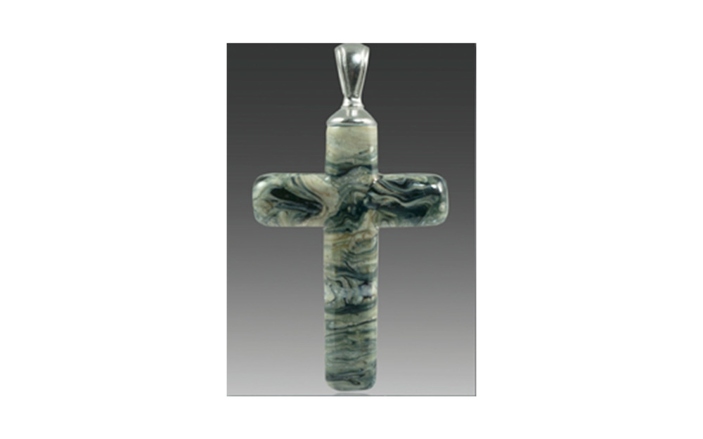 "Cross Pendant The Cross Pendant is available in Calico, Turquoise, Fossil, or Black Granite colors and comes with a silver or gold, plated bail. It contains your loved one's cremated remains swirling throughout the pendant. Each is custom made to order and comes with a leather cord.   Large: Measures 1 ¾"" x 1"", not including the size of the bail $195 Small: Measures 1 ¼"" x ¾"", not including the size of the bail $195"