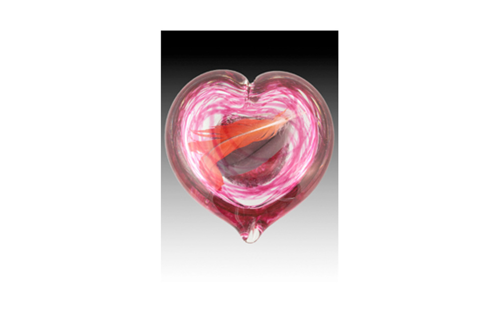 "Gathering Heart  Encased Memories in beautiful glass sculptures are now created as a way to preserve your precious memories. Items like flowers, dog tags, collars, leashes, feathers, fur clippings, and more can be showcased. After the piece is sculpted a small opening remains at the bottom to place your memory inside then it is sealed and encased forever. This keepsake comes in Blue, Aqua, Clear, Pulsar, Yellow, Green, Purple, and Red colors.  Large Heart: 4.5"" high & has an opening that is 1 1/2"" wide. $290"