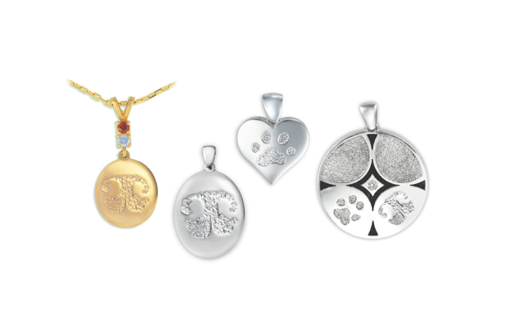 Buddies Pet Print Jewelry Whether your pet has passed away or is still with us you can keep close to your heart a print of their paw, nose, talon or hoof.  With your choice of 14k Yellow Gold, 14k White Gold, or .925 Sterling Silver we can have created for you a custom precious memory. Many different sizes and shapes are available, engraving and the setting of synthetic or genuine stones can be arranged. Other merchandise such as money clips, White Bronze Buddie Tags (dog tags), knifes, rings and Zippo lighters are all available with your pet's signature print on it. Prices vary depending upon the market so please inquire to receive current pricing.