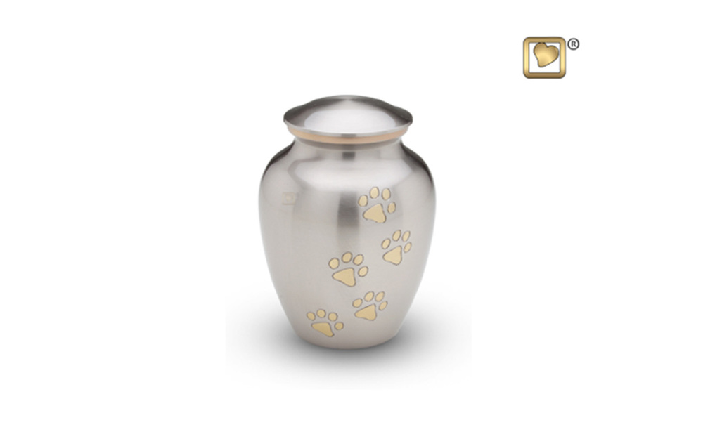 "Classic Pewter Paw Print Urn Made of Brushed Pewter with Brushed Brass Accents, comes in Large, Medium, and Small sizes Large: (8"" high, 105 Cu. Inches, up to 100 lbs.) $155 Medium: (7"" high, 70 Cu. inches, up to 65 lbs.) $145 Small: (6"" high, 40 Cu. inches, up to 35 lbs.) $125"