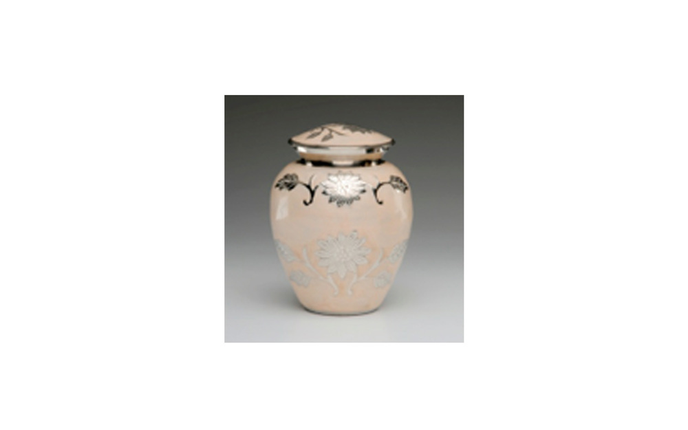 "Flowered Peach Colored Urn   This elegant urn is made of a Peach Colored Enamel over Nickel Plated Brass. It has a Hand-Tooled Flower Design, Threaded Lid, and a Felt-Lined Base. Comes in Large, Small, and Keepsake (see keepsakes) sizes.   Large:  Measures 6"" D x 10"" H, 200 Cu. Inches, up to 195 lbs.,  $130    Small:  Measures 5"" H, 40 Cu. Inches, up to 35 lbs.,  $74"