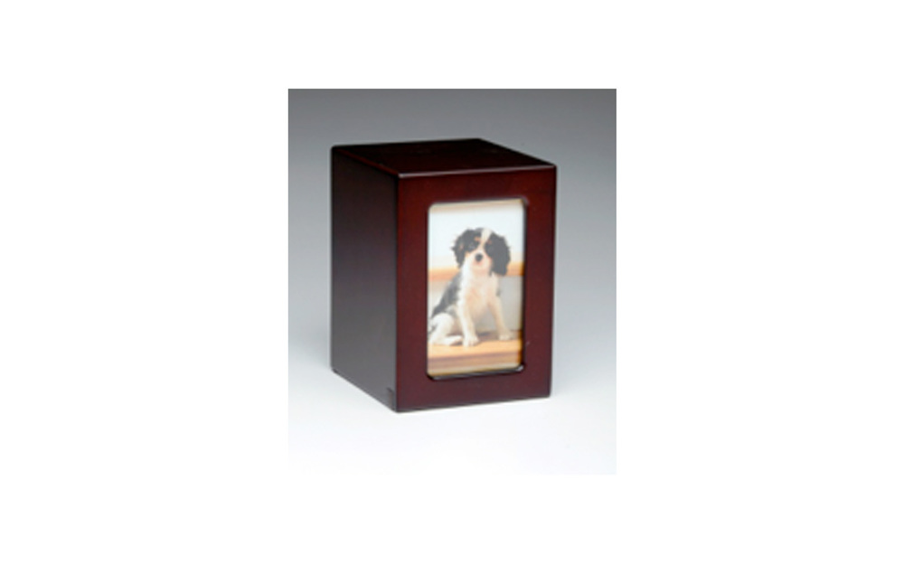 "Wooden Picture Frame Urn   This urn is made of engineered wood which is stained in a dark cherry finish. This wooden urn is very durable and comes in both large and medium sizes.   Large:  Outer Dimensions: 6.5"" L x 4.75"" W x 4.75"" D, Inner Dimensions:  5.5"" L x 3.75"" W x 3.75"" D  Photo size: 5"" x 3.25"", 75 Cu. Inches, up to 70 lbs.,  $115    Medium:   Outer Dimensions: 5.75"" L x 4"" W x 4.25""D, Inner Dimensions:  4.75"" L x 3"" W x 3.25"" D  Photo size: 4.5"" x 2.75"", 45 Cu. Inches, up to 40 lbs.,  $105"