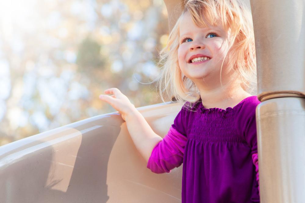 Smiling Girl on a Slide