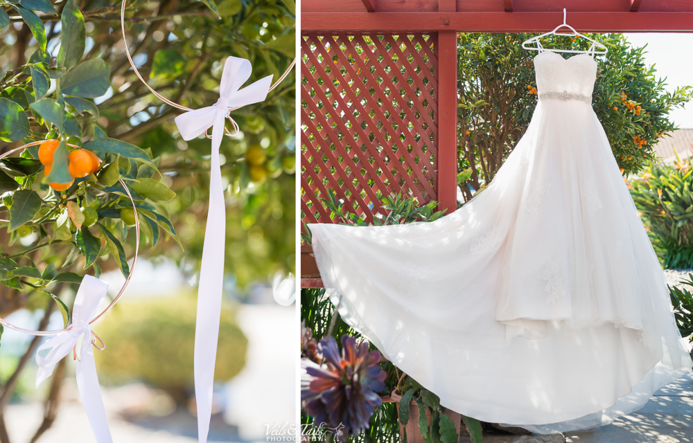 wedding dress hung up on gate with flowers