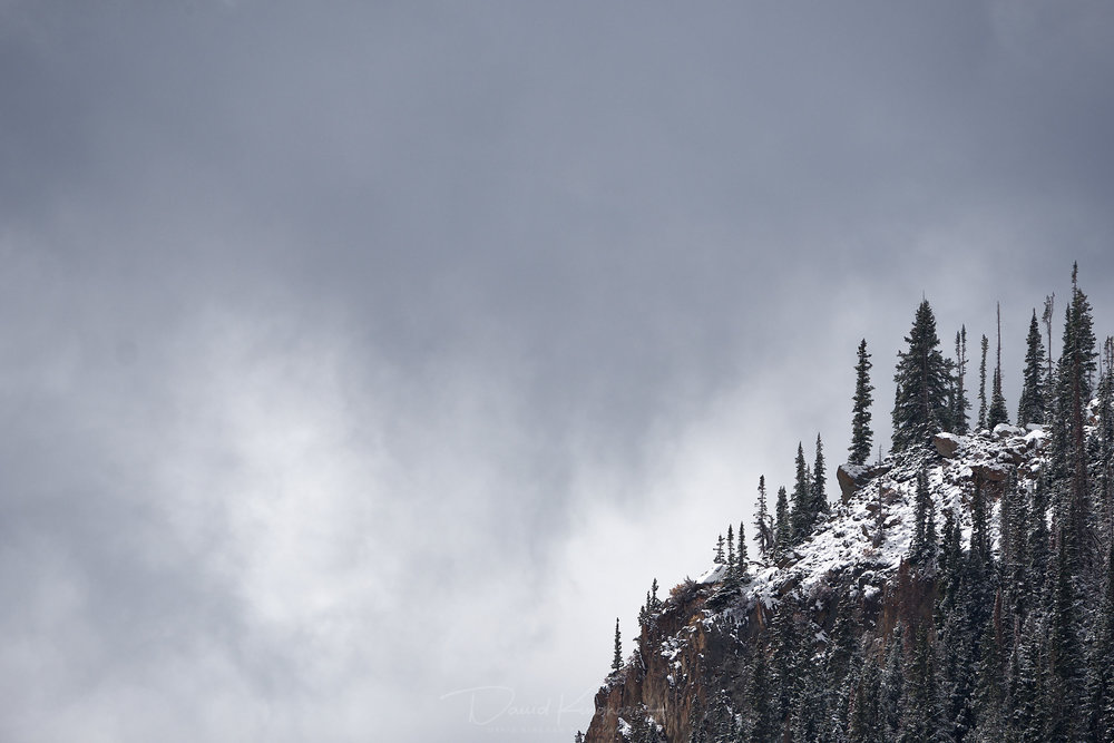 David Kingham - Fujifilm 100-400 @ 373mm (Equivalent focal length of 560mm), ISO 200, f/8, 1/900s Composition - Negative space gives foreboding scale to the mountain cliff