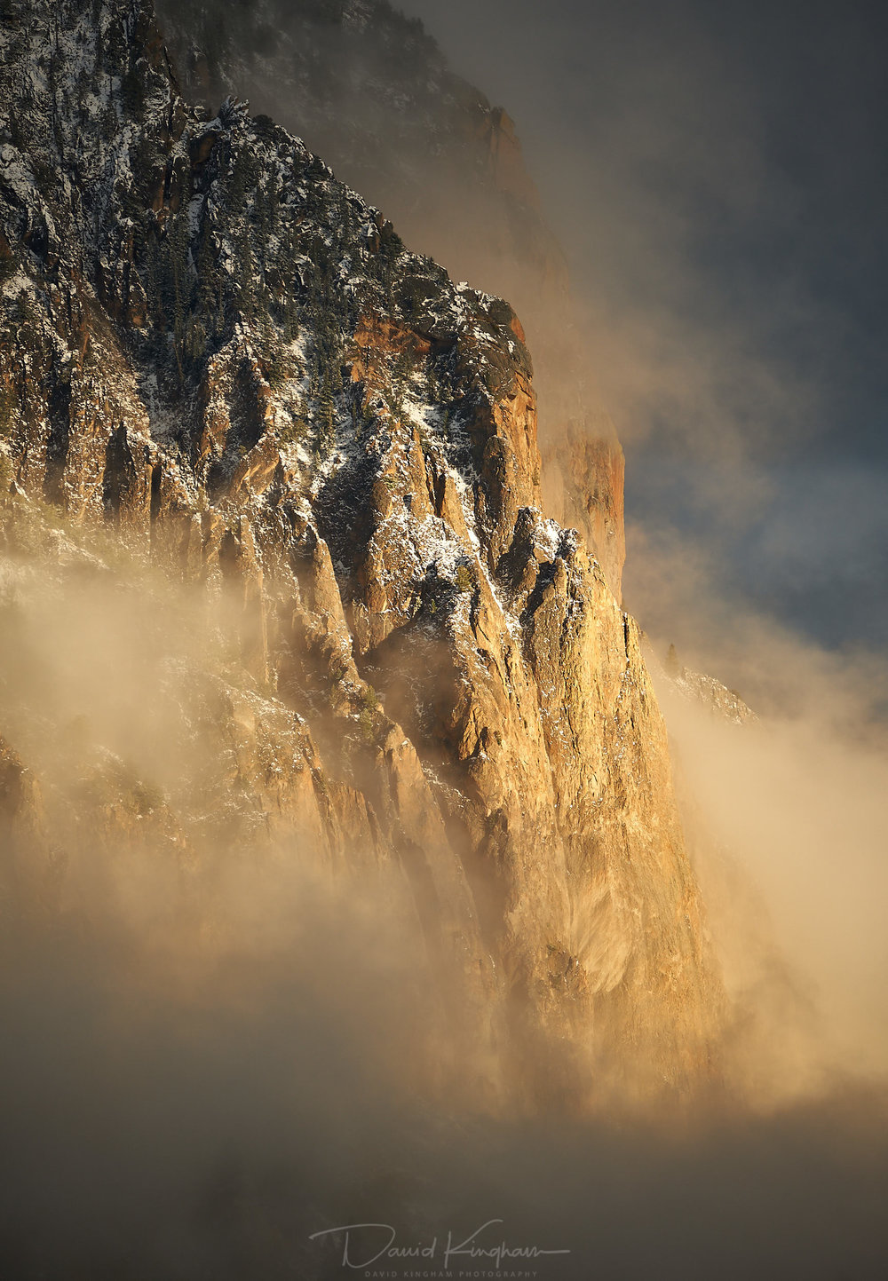 David Kingham  - Fujifilm 100-400 @ 347mm (Equivalent focal length of 520mm), ISO 200, f/5.6, 1/420s Composition - Contrast between cold, cloud shrouded mountain with the warm light of sunset