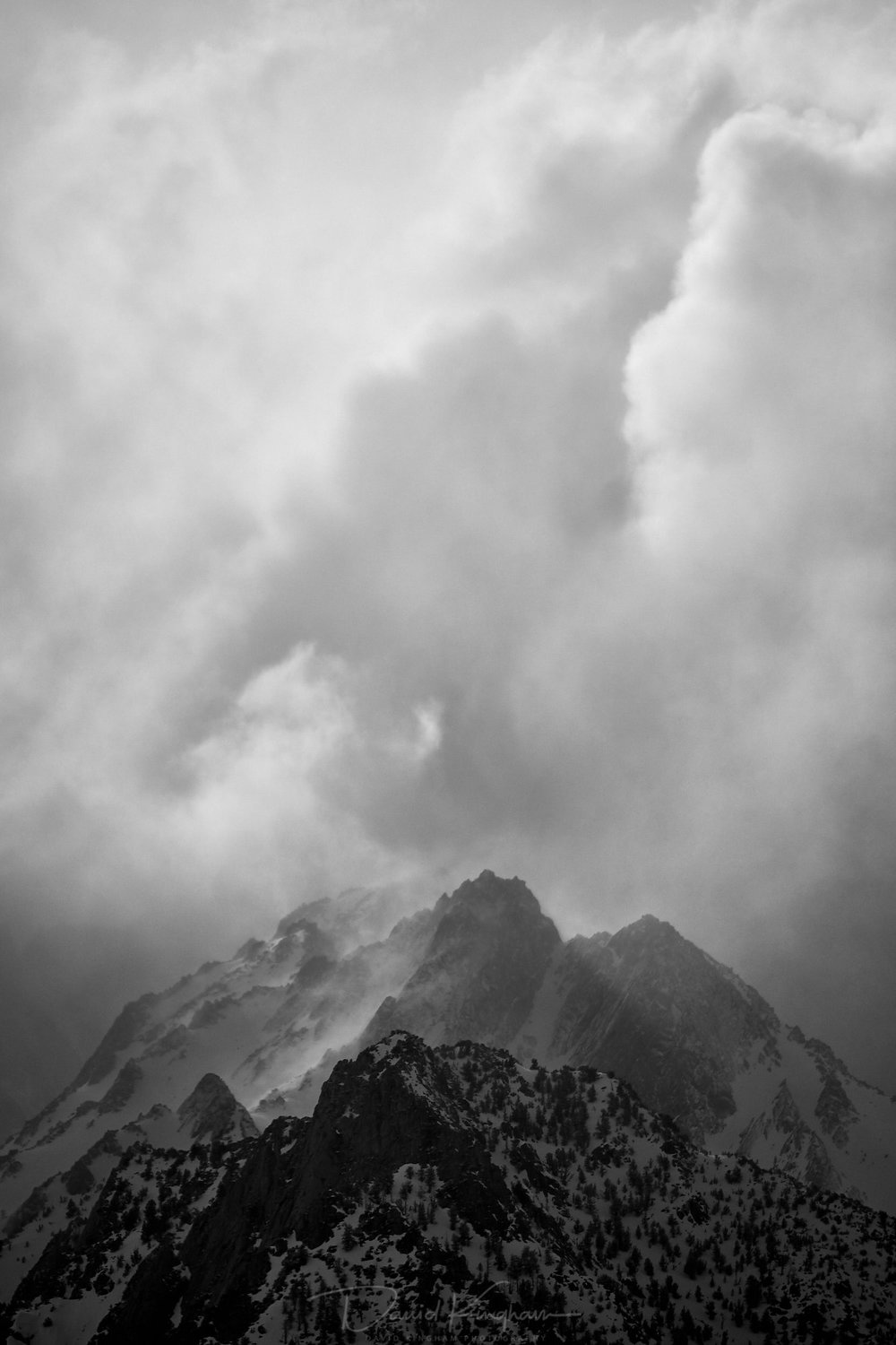 David Kingham  - Fujifilm 100-400 @ 252mm (Equivalent focal length of 378mm), ISO 200, f/5, 1/4500s Composition - Negative space gives breathing room for the immense mountain peak