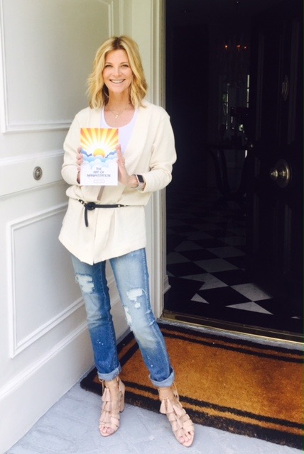 "Janet Gunn with her ""manual for life"" - The Art of Manifestation. A revolutionary, air-tight, step by step system for clearly mastering the manifestation process."