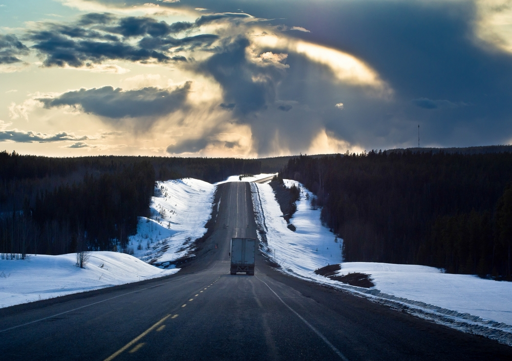 Snow Bordered Road & Stormy Sky