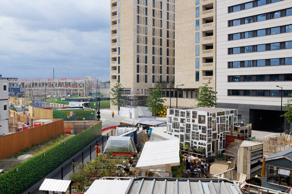 A garden space in the middle of a construction site: Global Generation