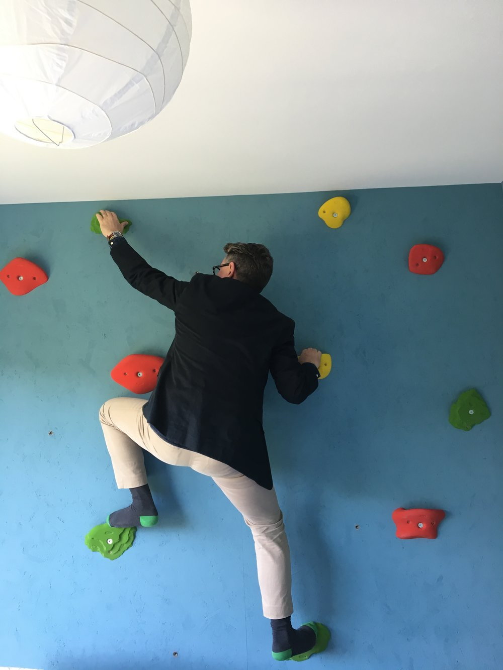 Brian tries out the climbing wall in our recently finished project in Muswell Hill.
