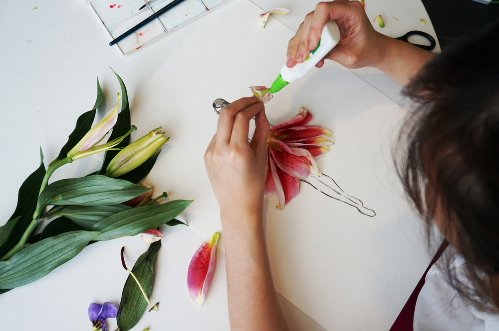 After some trial and error, you will achieve your desired look! Now it's time to pick up your glue and start putting those petals in place. It is important to be gentle with the petals, to prevent bruising them. Voila! And there you have your flower illustration.