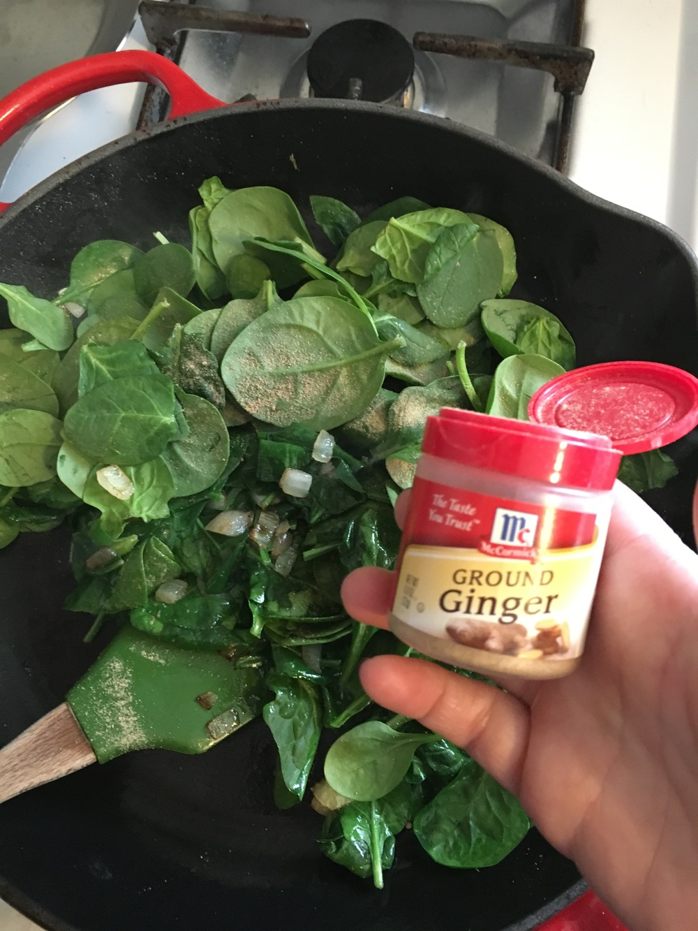 Add 6 cups of spinach and 1/4 teaspoon of ginger, cook till reduced in size