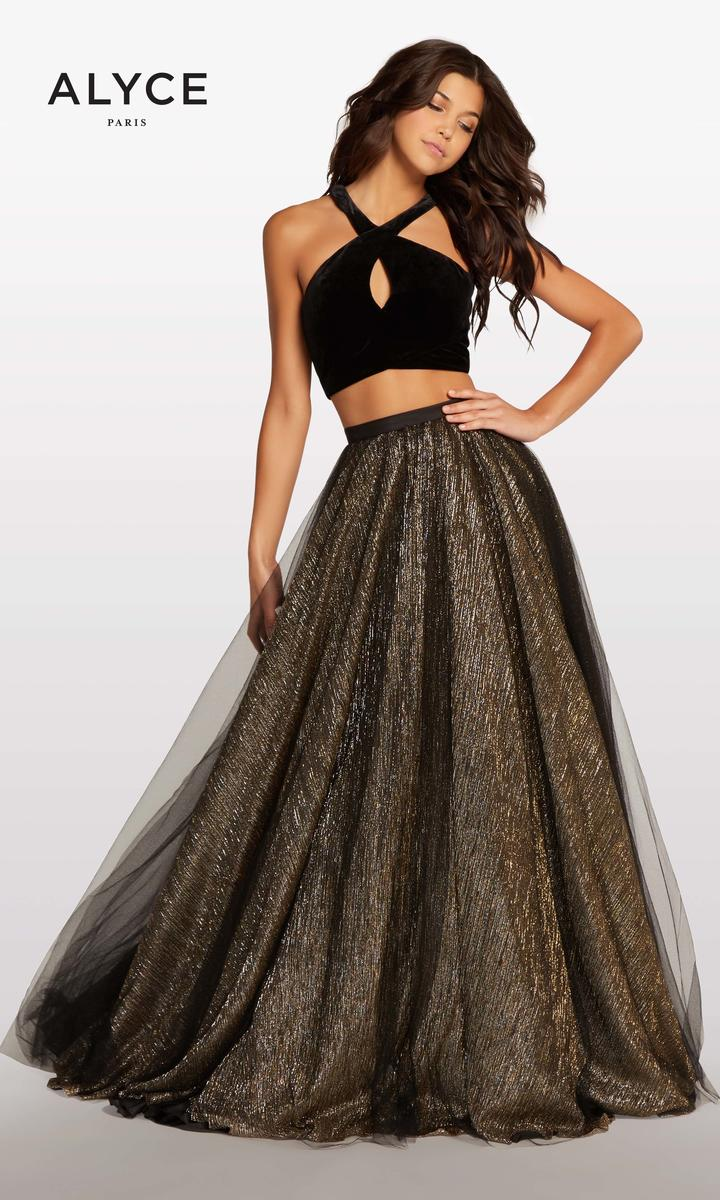 The top of this dress features a Y-neck, keyhole design in black velvet. The skirt has a sheer tulle overlay with an iridescent silver/gold skirt. We currently have this dress in stock and it available for ordering in different sizes.