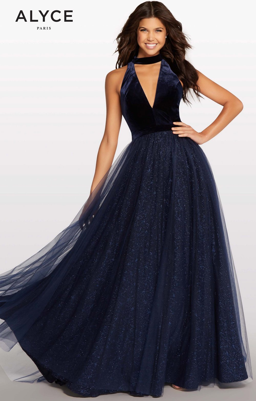 This navy dress has the ever so popular velvet choker top with a sparkly tulle ballgown skirt. We currently have this dress in stock and it available for ordering in different sizes.