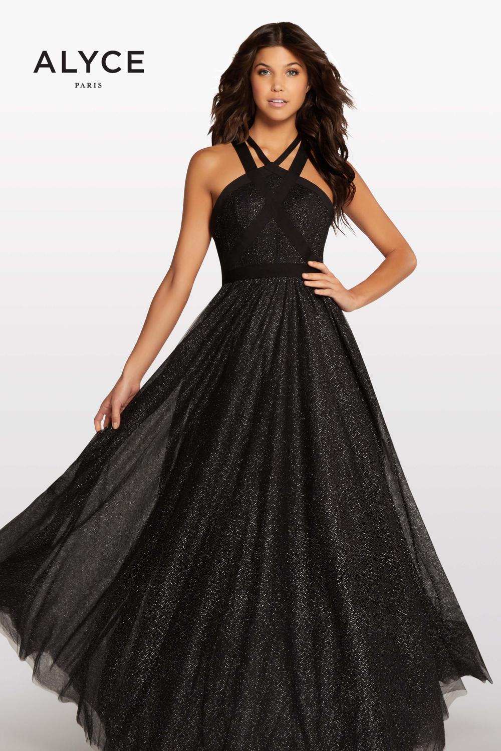 The criss-cross bandage top on this black a-line dress is unique and the subtle sparkle tulle on the skirt seals the deal on this beauty. We currently have this dress in stock and it available for ordering in different sizes.