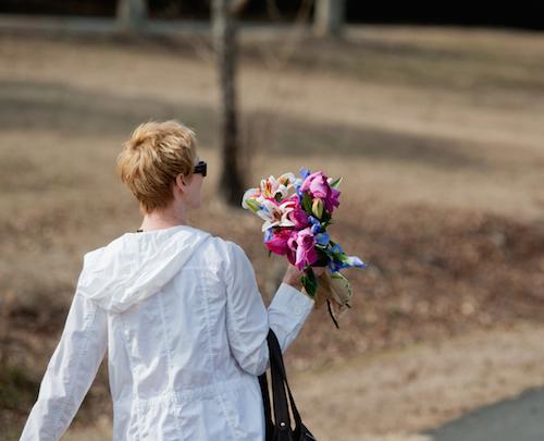 Tammy Walking with flowers sized.jpg
