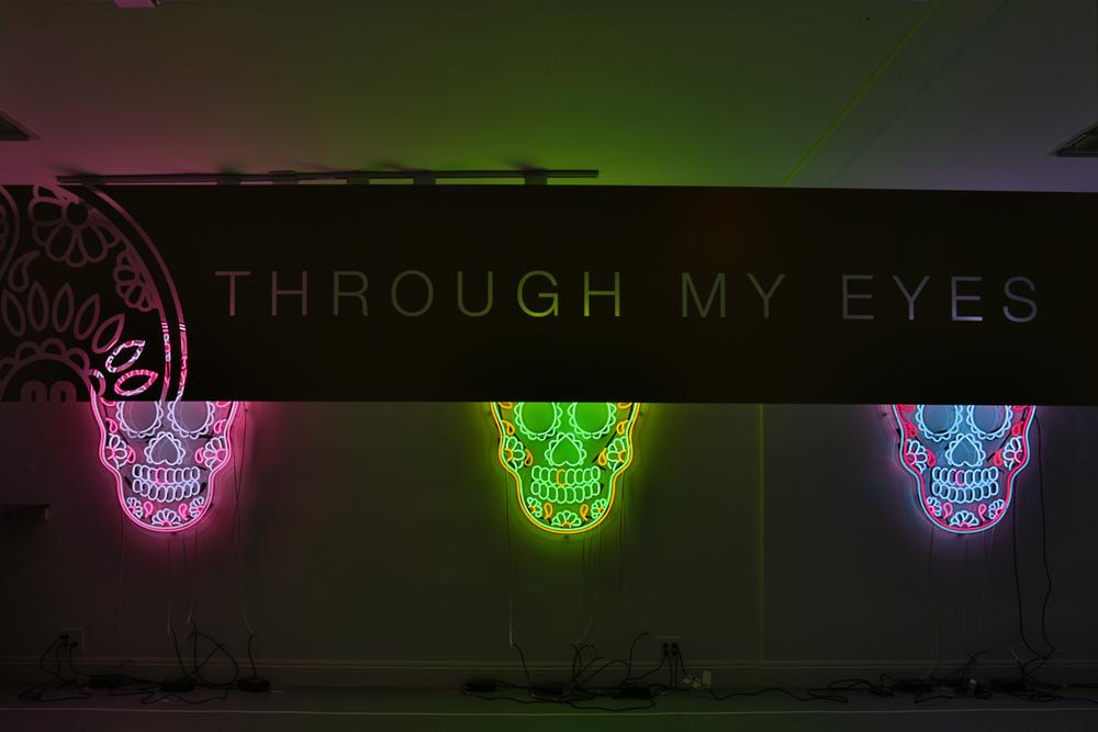 Window Neon Installation - Vector designed Dia De Los Muertos sugar skulls created with neon glass and vinyl die cut stickers.