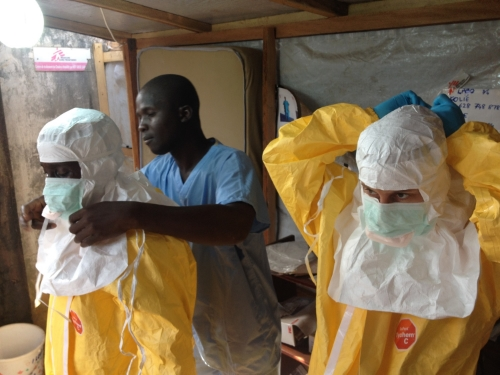 European Commission's Humanitarian Aid and Civilian Protection department (ECHO) workers suit up to contain the epidemic and run field tests on the Ebola virus. Photo credit EC/ECHO, Flickr Creative Commons.