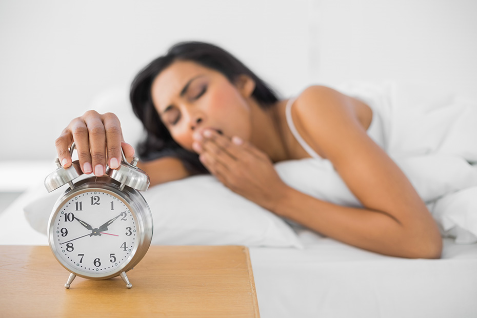 sleepy-yawning-woman-alarm-clock-030717.jpg