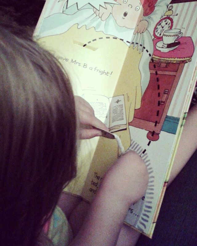 We've read the same book 6 times since we got up from naptime. I guess this mama did good on Pixie's new book.