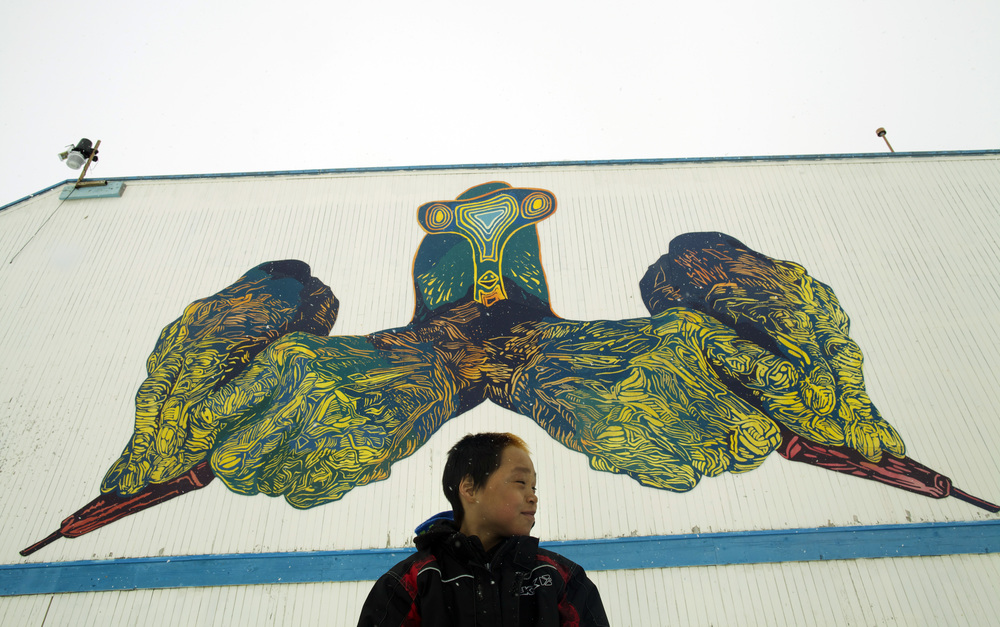 MINE YOUR IMAGINATION, Cape Dorset, Nunavut, Canada, 2014-2015   18x36', latex on mounted plywood   We created the hans in the mural by making original linocut prints, and projecting and painting them cut-for-cut: our way of giving a nod to the inspiring printmaking in Cape Dorset, past and present. The bird head was created by Parr Etidloie, 15 years old.    ( http://dorsetfinearts.com/aboutus.php)