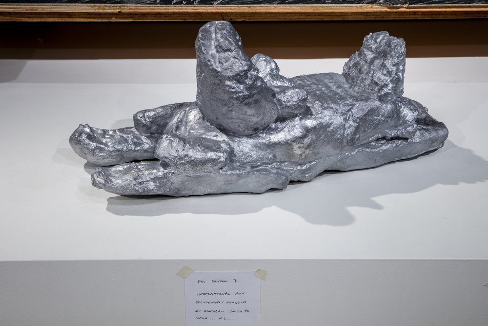 Aluminum cast of playdough snowmobile by Nathan Adla (age 13), handwritten notes of Embassy of Imagination dreams