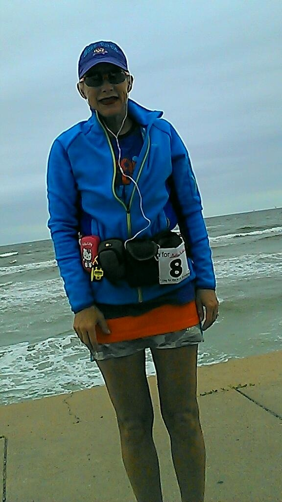 "Kimberley Sergeant supported 1 Day for the KIA by completing her own ultra marathon!  ""I ran in Galveston Texas. The picture is on the seawall with the gulf of Mexico in the background. I completed 50 miles."""