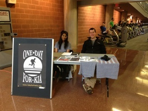 1DK Team Members Dannie D'Souza and Andy Smith working an information table at OSU's Recreation and Physical Activity Center.