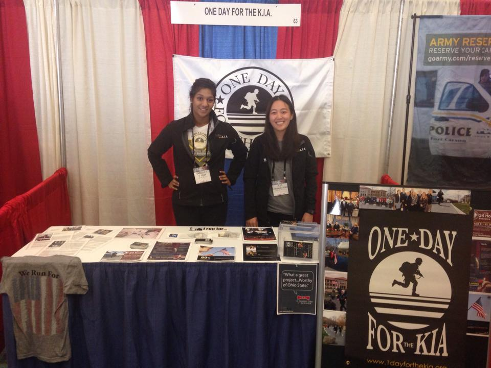 1DK members Dannie and Jessica working an information table at the Arnold Classic.