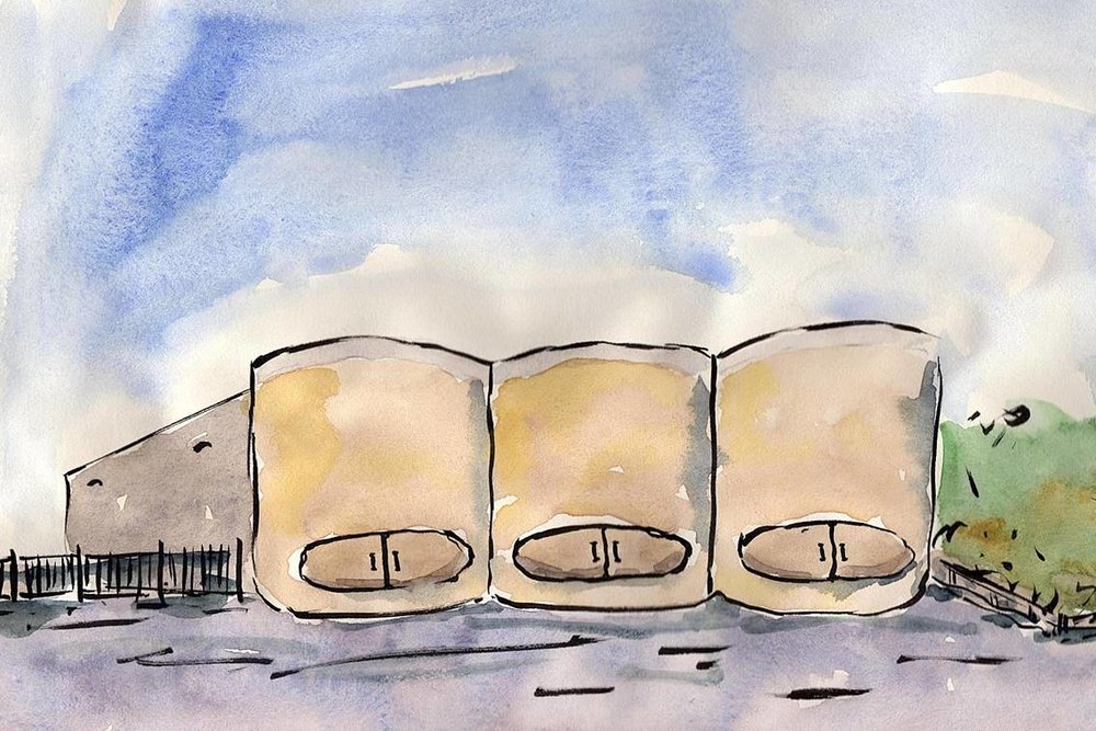I saw three huge vats full of grain in front of the Microchem building. The vats were so large that the width of the three covered the length of the Microchem building and they were as tall as the Microchem building so that the building was completely covered by the vats.