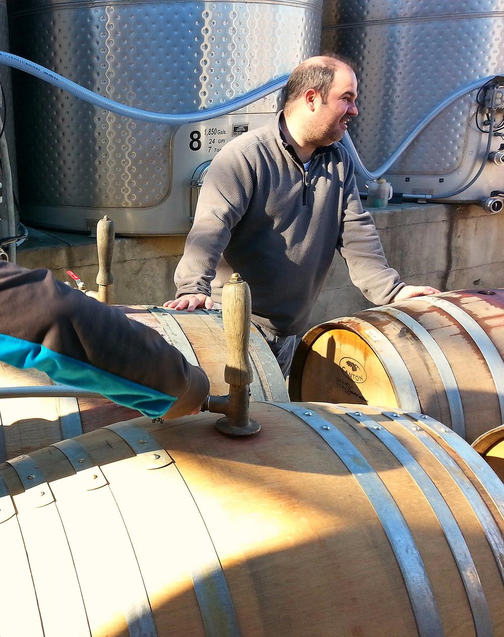 Winemaker and Owner, David Scheidt steam cleaning barrels