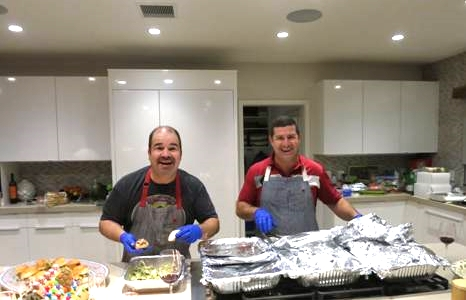 Life-Long friends Joe and Dave prepare dinner (with surgical gloves on)