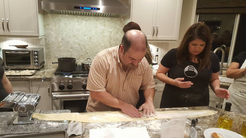 David rolls out the pasta dough with friend Trisha