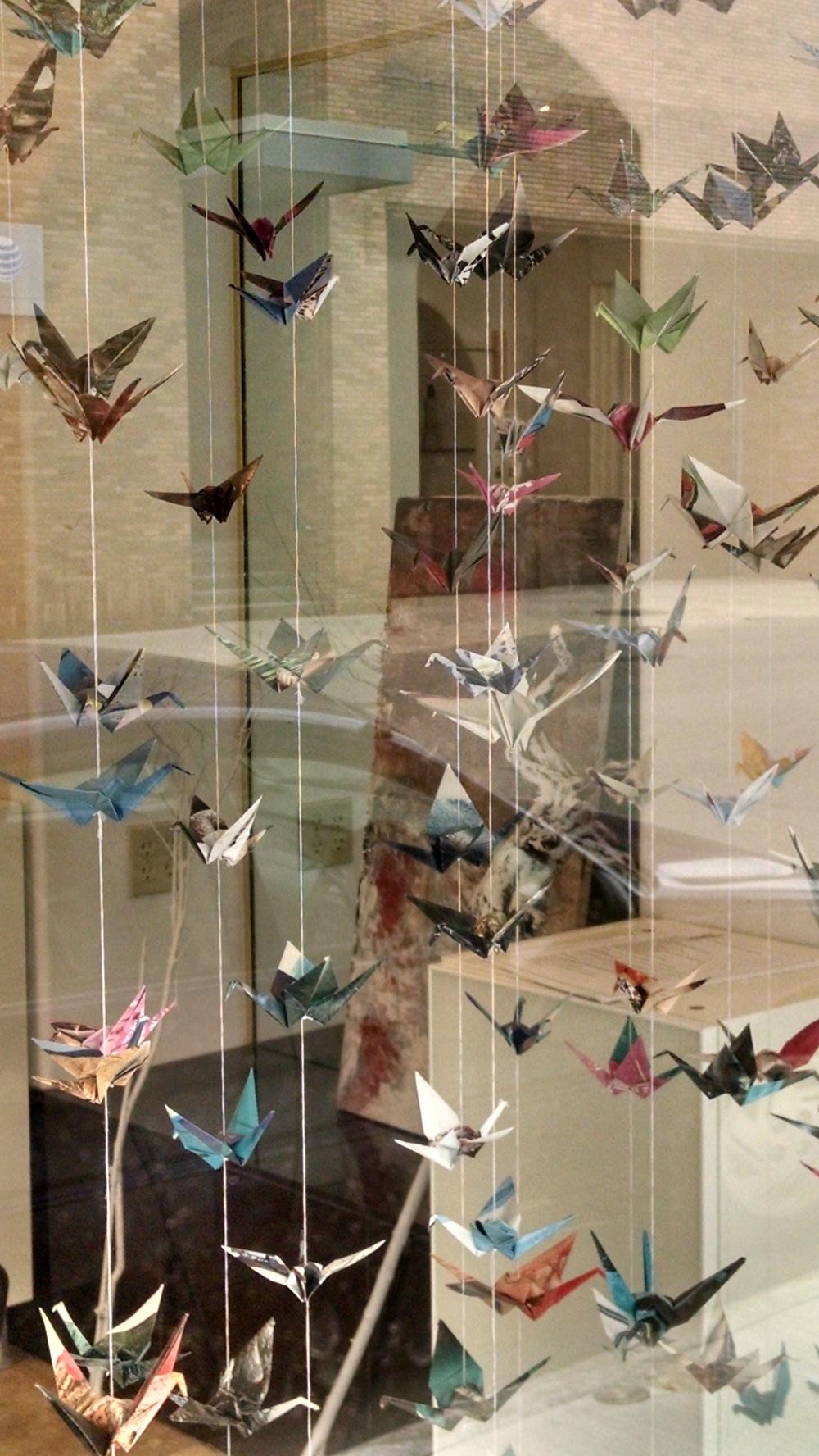Drue Salon window with commissioned paper cranes