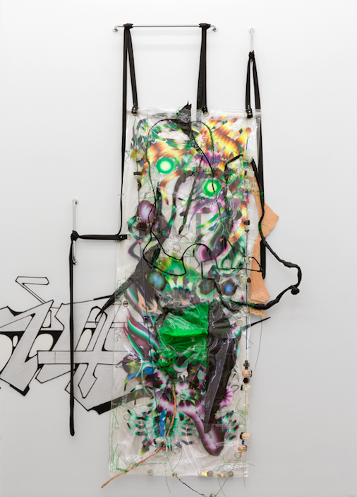 KAYA, Swarm Living Is For Bodybag Onion Braid, 2015. Metal, vinyl rope, oil on mylar, vinyl, grommets, epoxy, plexiglass tubing, and urethane, 180 1/8 x 86 11⁄16 x 11 13 ⁄16 in. (460 x 210 x 30 cm). Courtesy the artists. Photograph by Uli Holz
