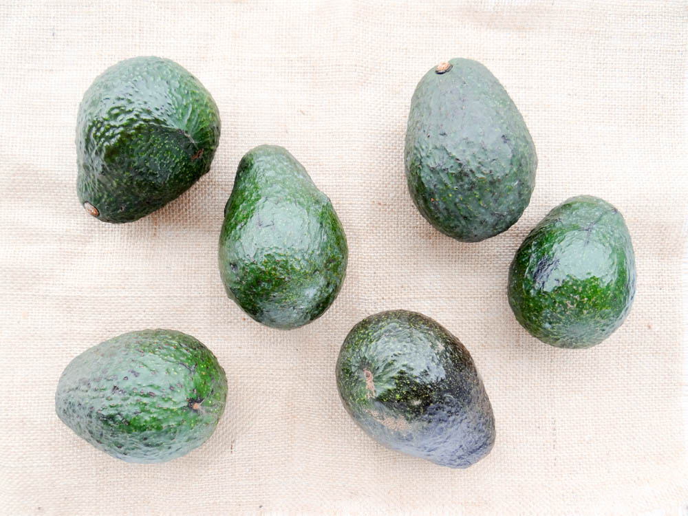 All unripe avocados, keep two out, put the rest in the fridge for later.