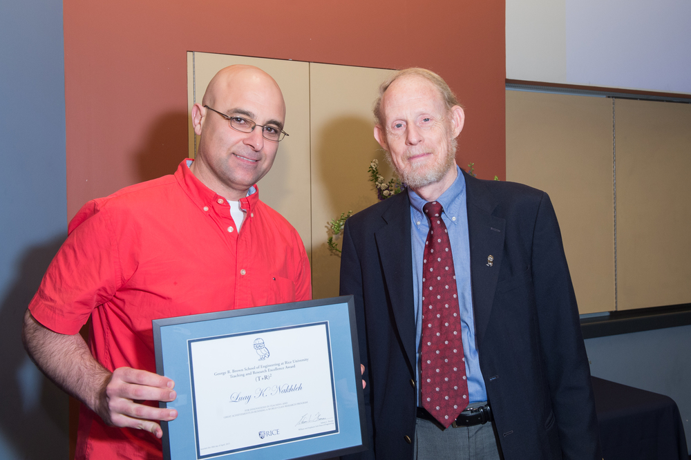 Associate Dean Bart Sinclair with Luay Nakhleh, Associate Professor of Computer Science