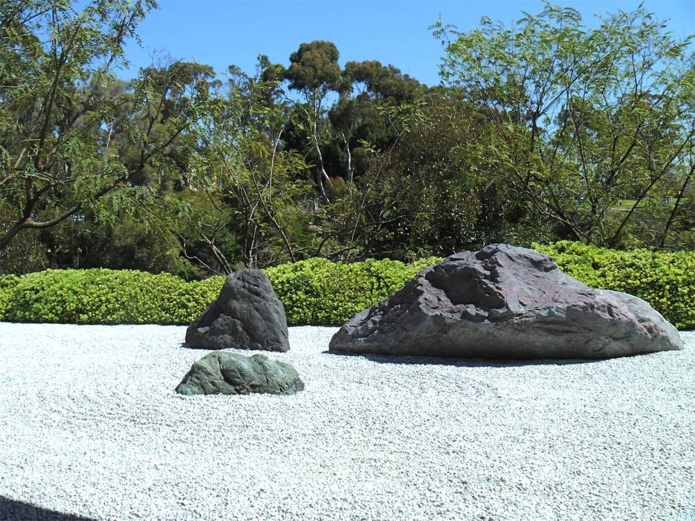 This rock garden represents islands in a sea. Large rocks are typically placed in 3's to represent the Buddhist trinity of heaven, earth, and man.